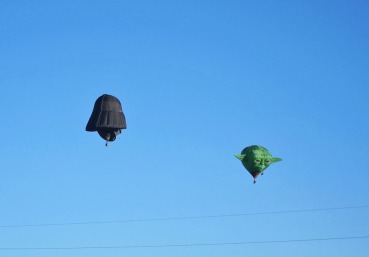 Darth Vader chasing Yoda across the sky by my house in the annual St. Patrick's Day Balloon Rallye