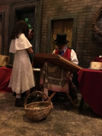 Young girl listening to the Zither Man in front of an old shop